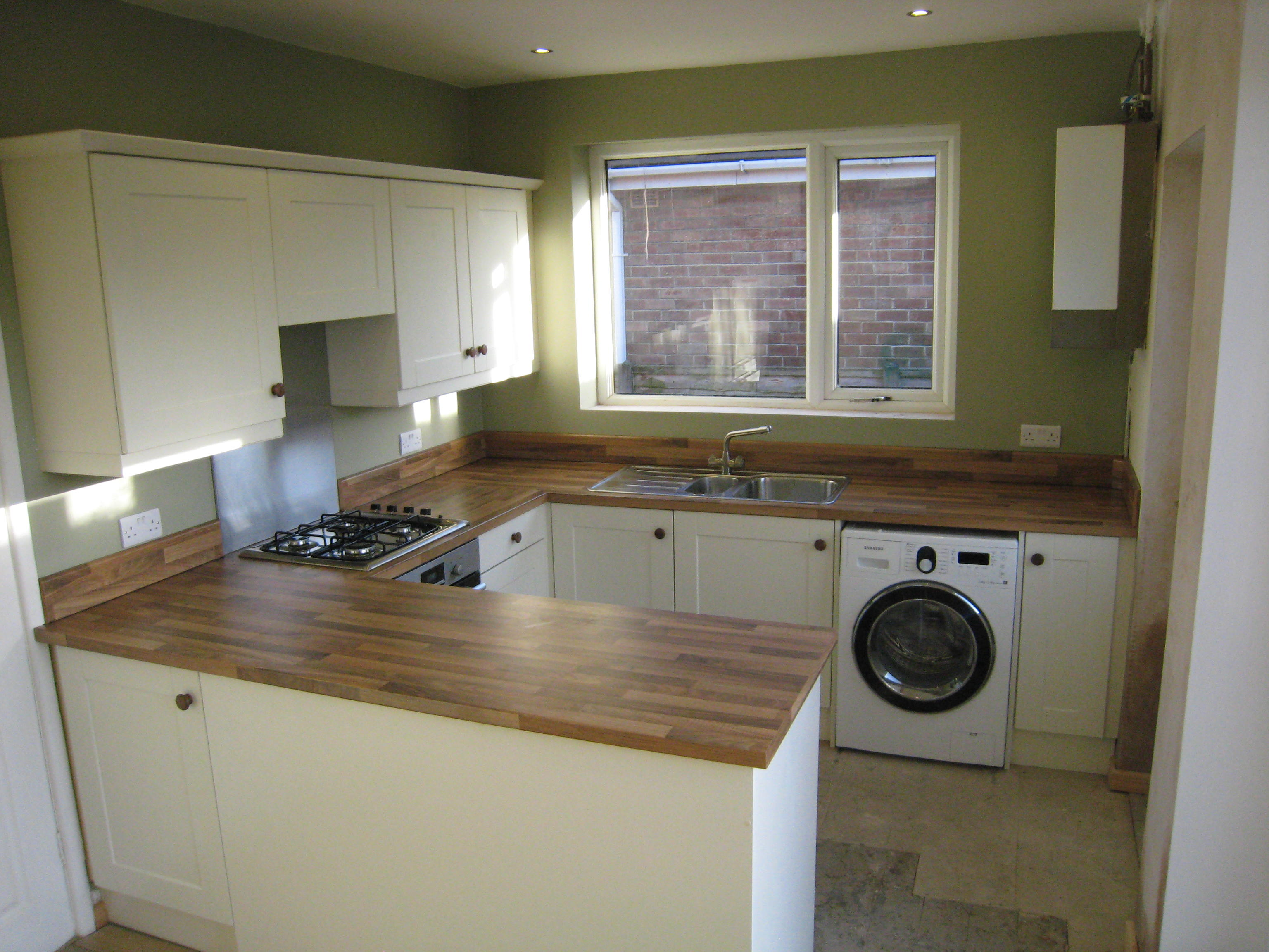 Fitted kitchens ivory kitchen with walnut block worktops for Small fitted kitchen ideas